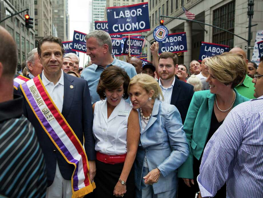 Gov. Andrew Cuomo of New York, left, and his gubernatorial primary opponent, Zephyr Teachout, far right, during a Labor Day Parade in New York, Sept. 6, 2014. Teachout's left-leaning challenge has gained a measure of attention, in part due to Cuomo's heavy-handed dismissals and refusals to debate. Also pictured: Cuomo's running mate, Kathy Hochul, second left, and behind her, Mayor Bill de Blasio. (Todd Heisler/The New York Times) Photo: TODD HEISLER / NYTNS