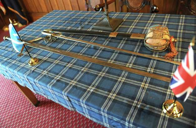 Swords are seen on a table in the meeting room at the St. Andrew's Society on Wednesday, Sept. 10, 2014 in Albany, N.Y. (Lori Van Buren / Times Union) Photo: Lori Van Buren / 00028556A