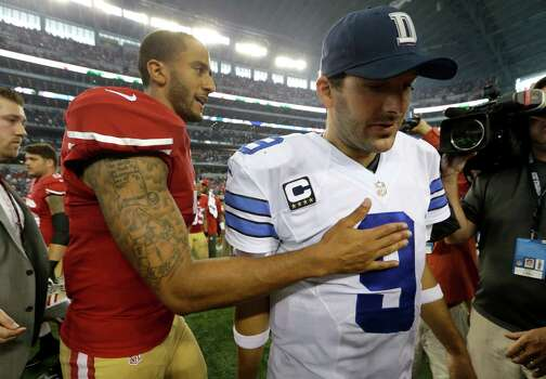San Francisco 49ers quarterback Colin Kaepernick taps Dallas Cowboys quarterback Tony Romo (9) on the chest after the two greeted each other on the field following their NFL football game, Sunday, Sept. 7, 2014, in Arlington, Texas. San Francisco won 28017.  (AP Photo/LM Otero) Photo: LM Otero, Associated Press / AP