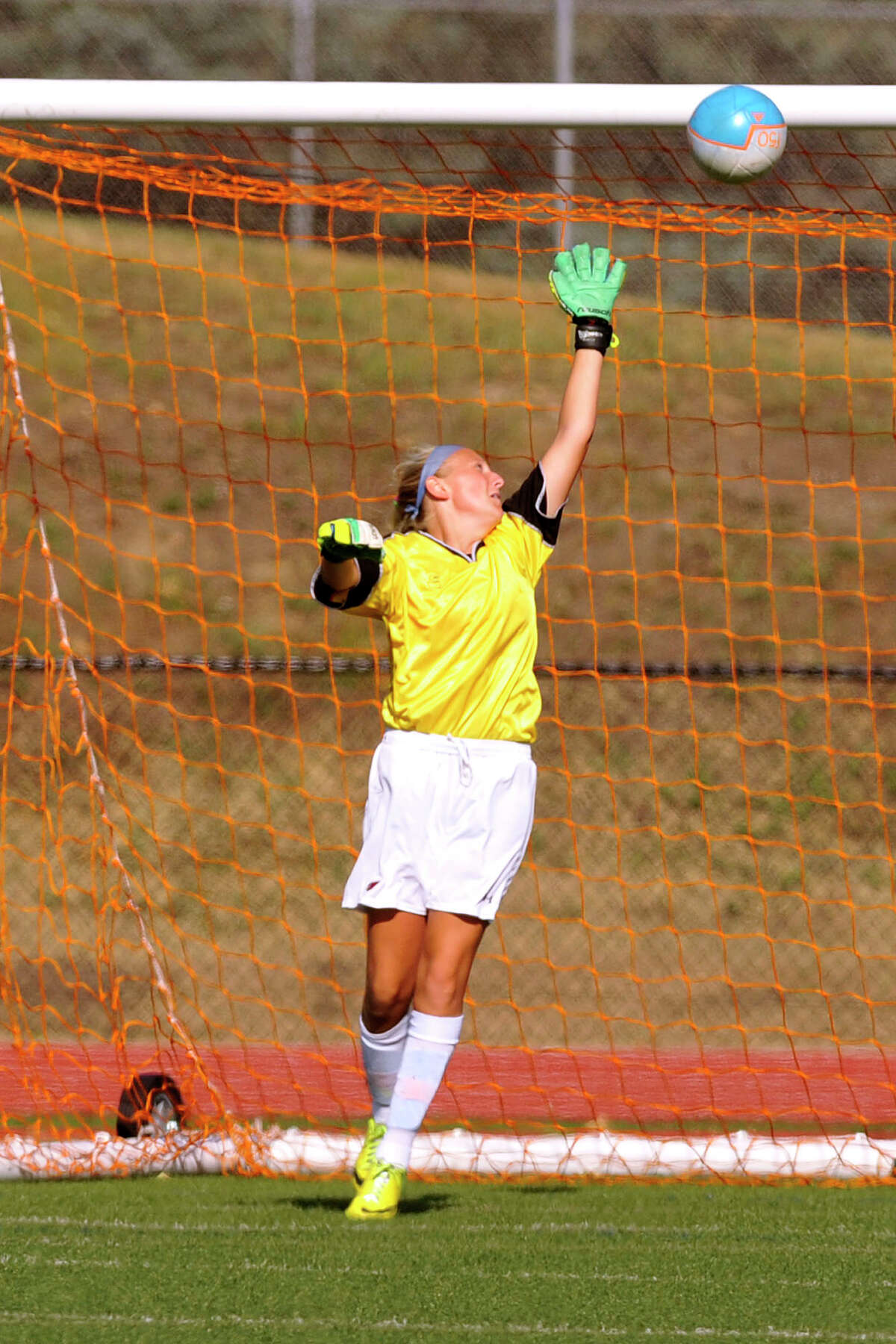 Greenwich goalie Emma Barefoot reaches for a ball just out of reach for a goal from the foot of Darien's Erin Karczewski during their soccer game at Greenwich High School in Greenwich, Conn., on Wednesday, Sept. 10, 2014. Darien won, 3-0.