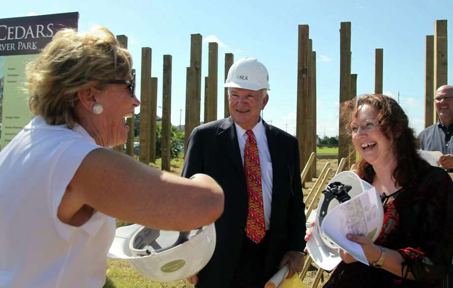 Buddy Herz, center, chairman of the Galveston Housing Authority Board, smiles before the groundbreaking for new public housing that has come after years of bitter debate over whether to rebuild after the devastation of Hurricane Ike. Photo: Billy Smith II, Staff / © 2014 Houston Chronicle