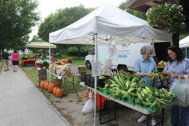 The farm stands of Gomez Veggie Ville, left rear, and Butternut Ridge Farms, foreground, at the Saratoga Farmers' Market on Wednesday Sept. 10, 2014, in Saratoga Springs, N.Y. (Michael P. Farrell/Times Union) Photo: Michael P. Farrell / 00028553A