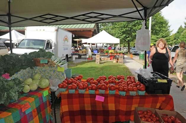 The farm stands of Gomez Veggie Ville,foreground, and Butternut Ridge Farms,background, at the Saratoga Farmers' Market on Wednesday, Sept. 10, 2014, in Saratoga Springs, N.Y. (Michael P. Farrell/Times Union) Photo: Michael P. Farrell / 00028553A