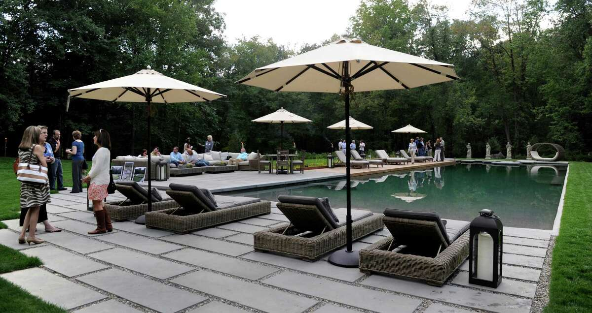 The owners of Freddys Landscape Company unveil a new eco-friendly pool recently completed at a clients home on Taunton Hill Road in Newtown, Conn. It was created out of an existing pond on the site.