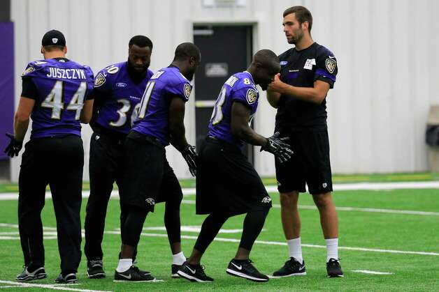 OWINGS MILLS, MD - SEPTEMBER 08: Quarterback Joe Flacco #5 of the Baltimore Ravens (R) talks with members of the offense during practice at their training facility on September 8, 2014 in Owings Mills, Maryland. Earlier in the day the Ravens terminated the contract of running back Ray Rice and the NFL suspended him indefinitely after the release of video showing Rice striking his then-fiancA©e in a hotel elevator.  (Photo by Rob Carr/Getty Images) ORG XMIT: 511638639 Photo: Rob Carr / 2014 Getty Images