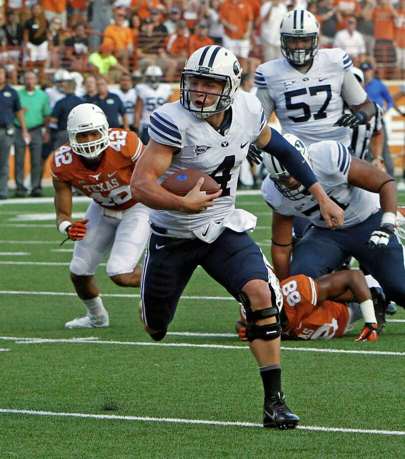 BYU quarterback Taysom Hill rushed for 99 yards in a 41-7 victory over Texas. Photo: Michael Thomas, FRE / FR65778 AP