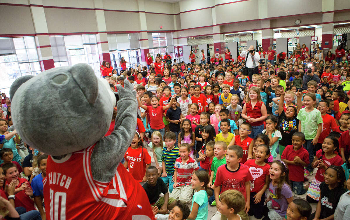 Gleason Elementary School students watch as the Houston Rockets' mascot, Clutch, instructs them during a visit to the school, Wednesday, Sept. 10, 2014, in Houston.
