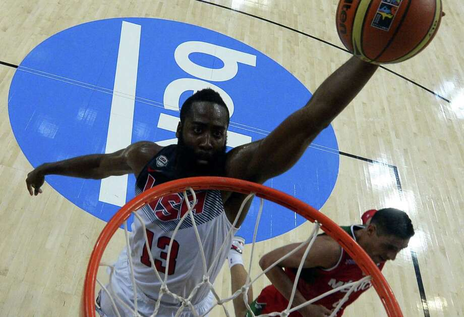 """James Harden, soaring toward the rim in the United States' win over Mexico on Saturday, jumped at the opportunity to play for his country. """"This is a dream come true,"""" he said. Photo: Lluis Gene / AFP / Getty Images / AFP"""