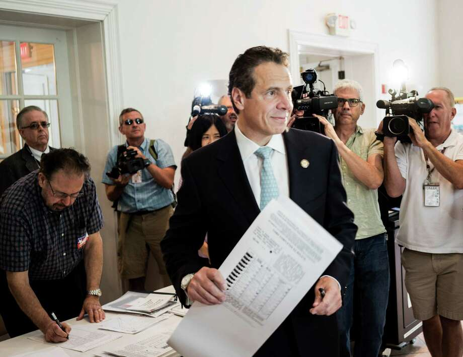 Gov. Andrew Cuomo votes at his polling station in Mount Kisco, N.Y., Sept. 9, 2014. Cuomo is widely expected to see off a challenge from law professor Zephyr Teachout the Democratic primary, but the race is being closely watched for signs of Cuomo's standing with liberal voters. (Andrew Sullivan/The New York Times) Photo: ANDREW SULLIVAN / NYTNS