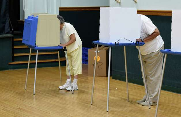 Voters in Tuesday's primary make their choices, Sept. 9, 2014, at the Bethlehem Town Hall polling place in Bethlehem, N.Y.     (Skip Dickstein/Times Union) Photo: SKIP DICKSTEIN / 00028566A