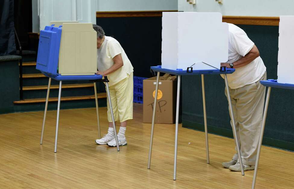Voters in Tuesday's primary make their choices, Sept. 9, 2014, at the Bethlehem Town Hall polling place in Bethlehem, N.Y. (Skip Dickstein/Times Union)