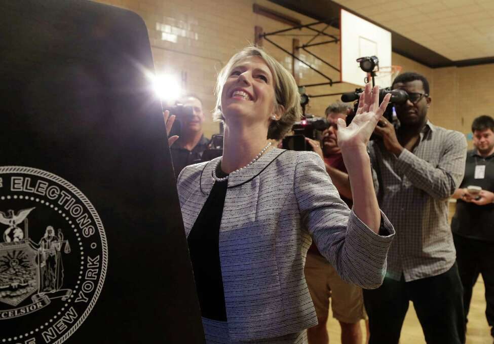 Zephyr Teachout, a Democratic gubernatorial candidate, holds up her hands after casting her ballot in the primary election, Tuesday, Sept. 9, 2014 in the Brooklyn borough of New York. Teachout is challenging Gov. Andrew Cuomo as he seeks a second term in office. (AP Photo/Mark Lennihan)