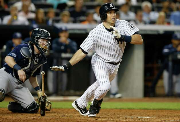 Tampa Bay Rays catcher Ryan Hanigan, left, watches as New York Yankees Mark Teixeira watches his fifth-inning, RBI single off Tampa Bay Rays starting pitcher Jake Odorizzi in a baseball game at Yankee Stadium in New York, Wednesday, Sept. 10, 2014. (AP Photo/Kathy Willens) ORG XMIT: NYY113 Photo: Kathy Willens / AP
