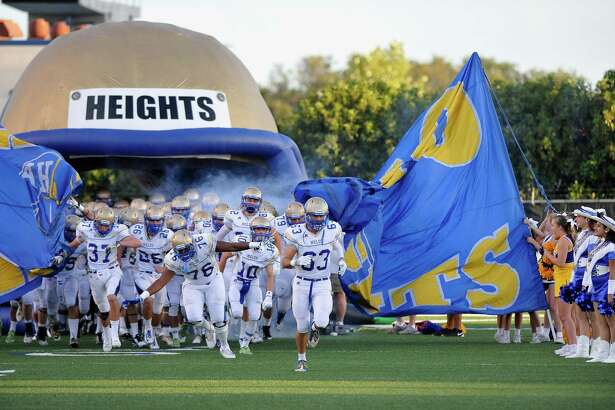 Alamo Heights players take the field before a high school football game against O'Connor, Friday, Sept. 5, 2014, at Farris Stadium in San Antonio. (Darren Abate/For the Express-News)