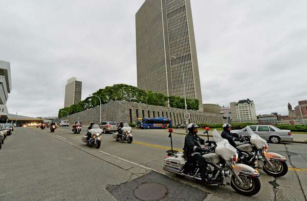 Motorcycle riders left Albany headed for New York City to honor first responders to the 9/11 attacks on the 13th anniversary of the attacks on the World Trade Center Thursday morning Sept. 11, 2014 in Albany, N.Y.  The motorcade will join with others including Governor Cuomo in New York City later this morning.    (Skip Dickstein/Times Union) Photo: SKIP DICKSTEIN