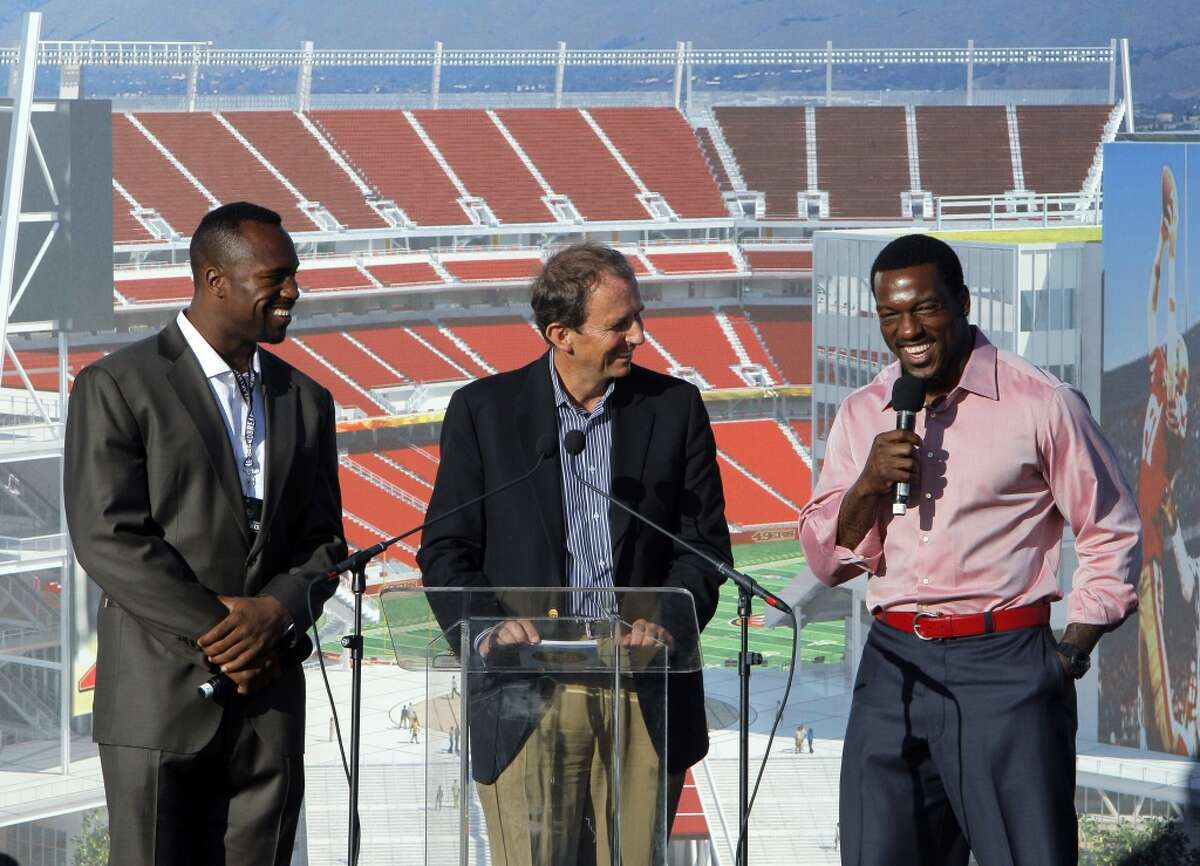 49ers' Vernon Davis, left, and broadcaster Ted Robinson, center, listen as Patrick Willis addresses the crowd gathered 49ers stadium in Santa Clara.