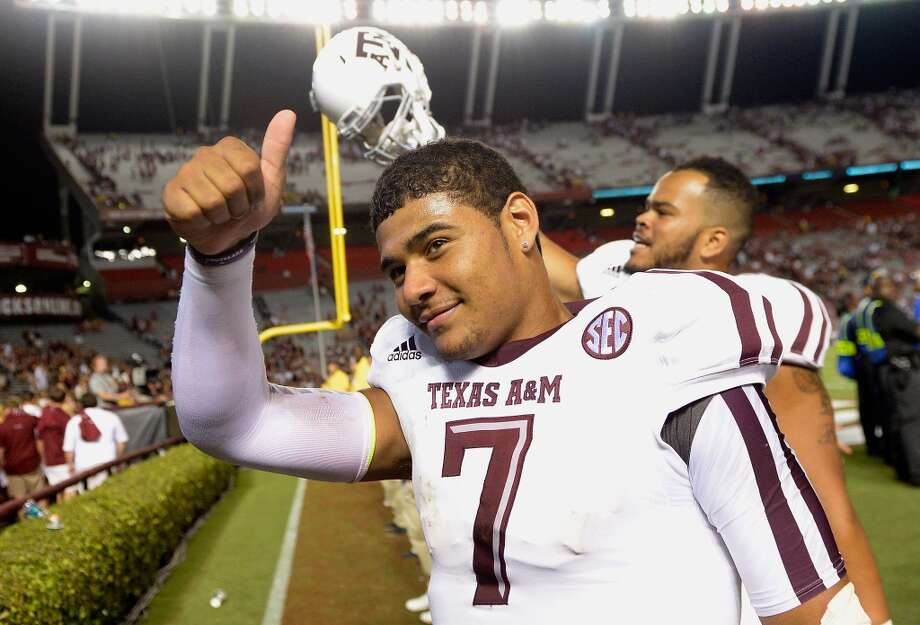 Kenny Hill #7 of the Texas A&M Aggies flashes a thumbs-up as he leave the field afte a win over the South Carolina Gamecocks at Williams-Brice Stadium on August 28, 2014 in Columbia, South Carolina. Texas A&M won 52-28.  (Photo by Grant Halverson/Getty Images) Photo: Grant Halverson, Getty Images