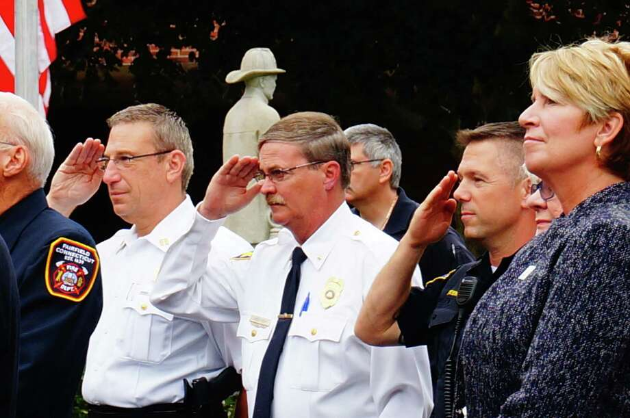 The Fire Department hosted the town's annual observance of the Sept. 11, 2001 terrorist attacks, with a ceremony attended by police, firefighters, town officials and residents. Photo: Genevieve Reilly / Fairfield Citizen