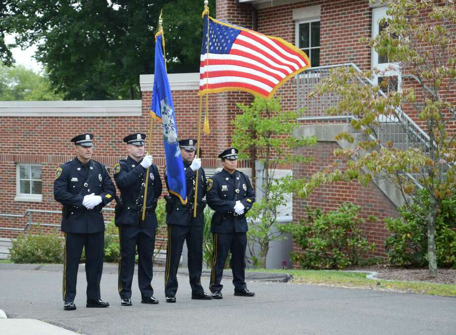 The New Canaan Police Department's Honor Guard team prepares to present the colors during a ceremony Thursday morning, Sept. 11, 2014, commemorating the 11th anniversary of the Sept. 11 terrorist attacks. Photo: Nelson Oliveira / New Canaan News