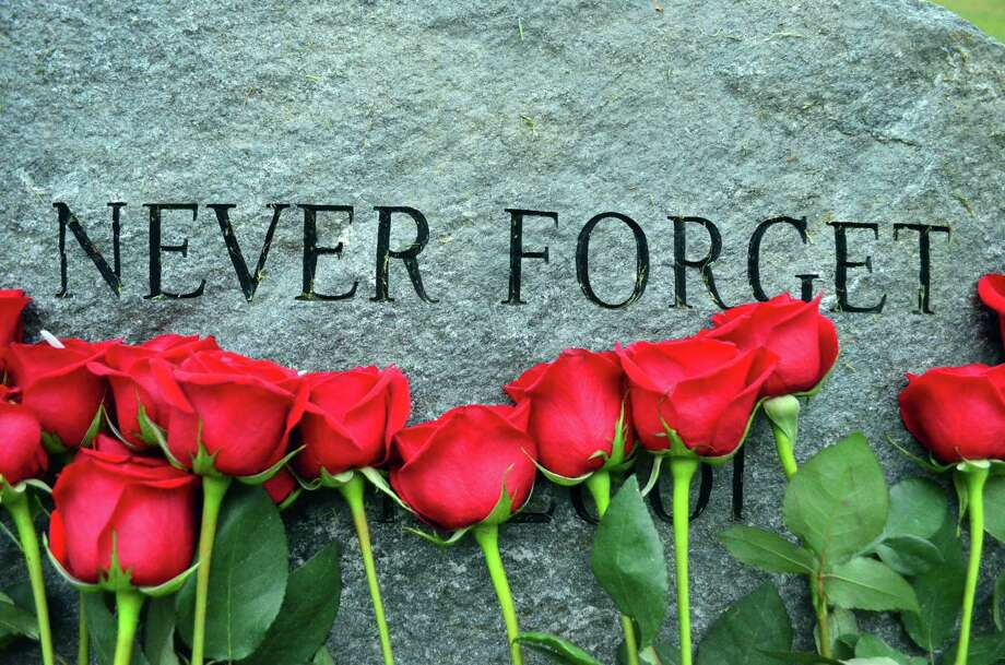 Roses and flags were placed at the September 11 memorial behind Middlesex Middle School on Sept. 11, 2014. A moment of silence was recognized at 8:46 a.m., the time the first tower was struck. Photo: Megan Spicer / Darien News
