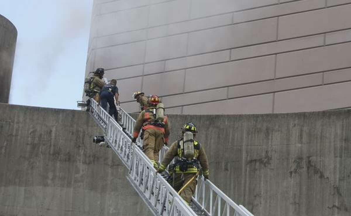 Houston firefighters respond to a fire at the Alley Theater at Louisiana and Texas in downtown.