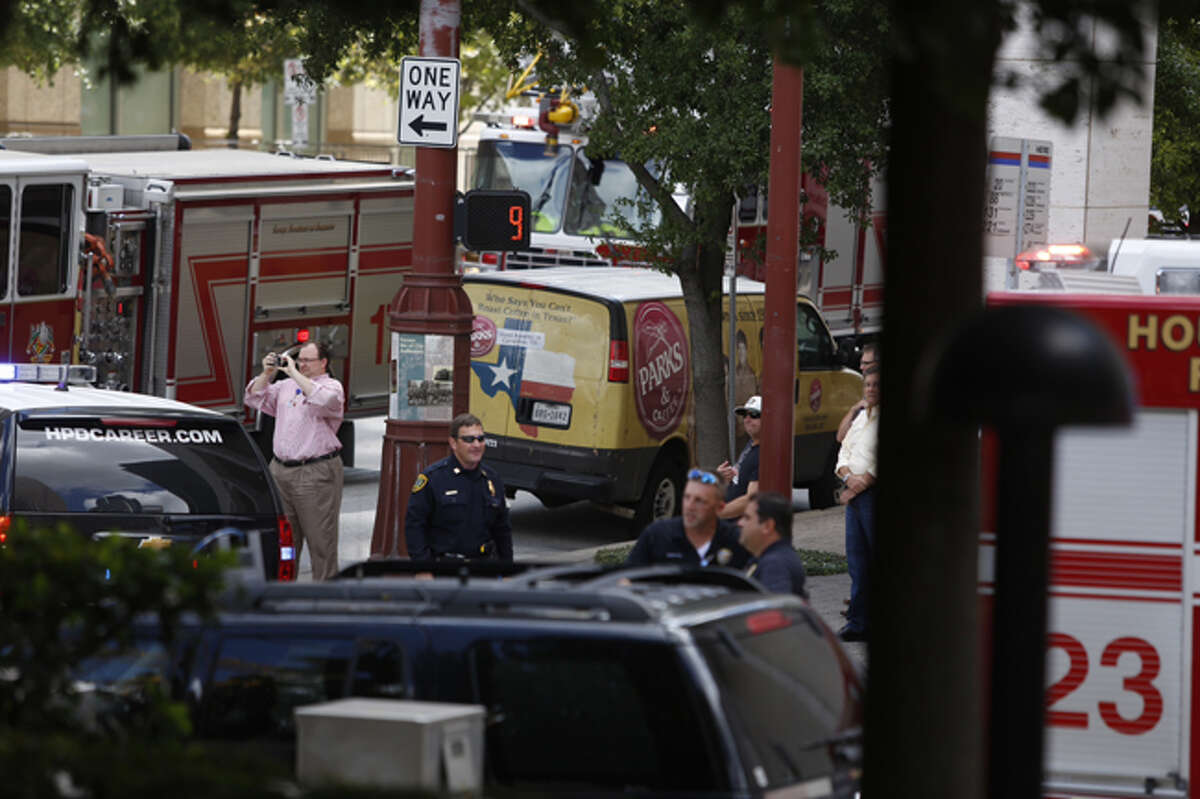 Houston firefighters respond to an alarm just before noon Thursday at the Alley Theater in downtown Houston.