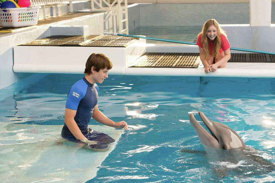 "Nathan Gamble and Cozi Zuehlsdorff co-star with Winter in ""Dolphin Tale 2."" Photo: Wilson Webb, HO / MCT"