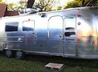 Austin - Vintage Airstream  Live the mobile life in this camper with two beds, a kitchen and a washer for $89 per night.