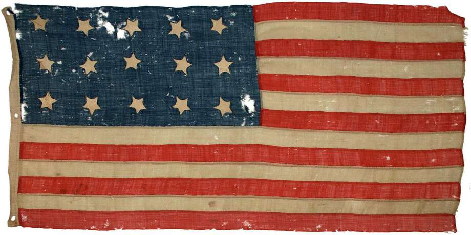 A 15-star American flag from the War of 1812 era, a contemporary of the flag that inspired Francis Scott Key to write what is now the national anthem. Photo: Contributed Photo / Fairfield Citizen