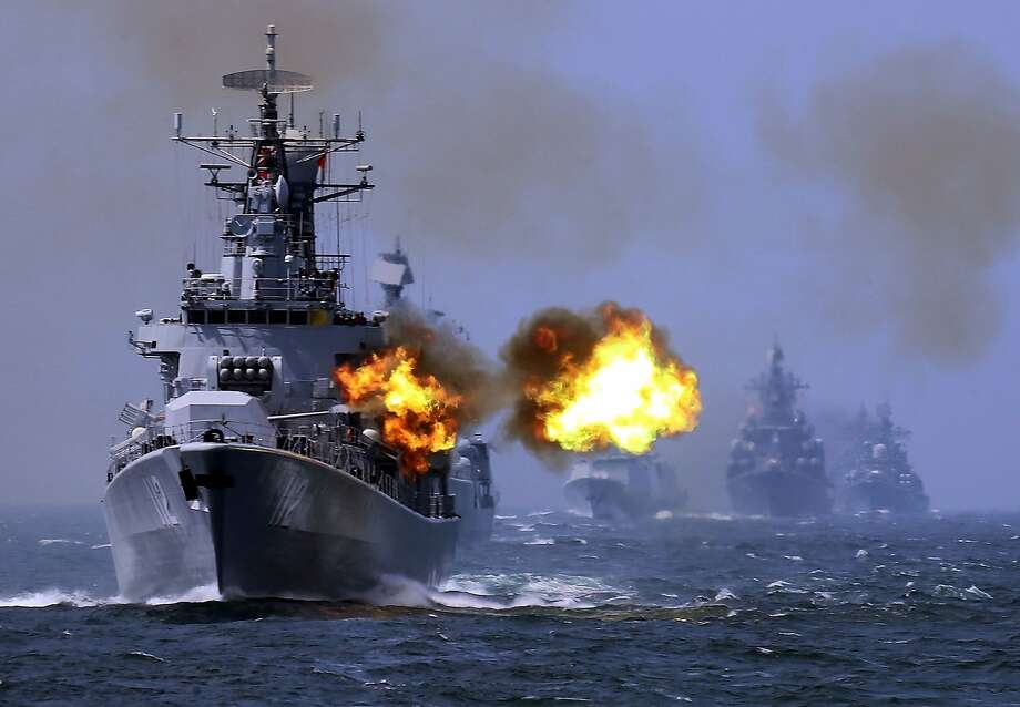 """In this May 24, 2014 photo, China's Harbin (112) guided missile destroyer takes part in a week-long China-Russia """"Joint Sea-2014"""" navy exercise at the East China Sea off Shanghai, China. Several Asian nations are arming up, their wary eyes fixed squarely on one country: a resurgent China that's boldly asserting its territorial claims all along the East Asian coast. The scramble to spend more defense dollars comes amid spats with China over contested reefs and waters. Other Asian countries such as India and South Korea are quickly modernizing their forces, although their disputes with China have stayed largely at the diplomatic level. (AP Photo) Photo: Associated Press"""