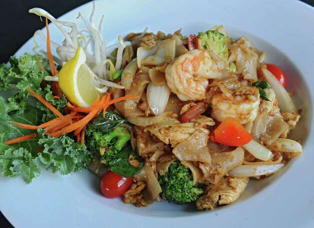 "Kee Mao at BBK Bistro at 728 Loudon Rd. on Thursday, Aug. 14, 2014 in Latham, N.Y. Sauteed flat ""drunken"" rice noodles with shrimp, Thai basil, broccoli, tomatoes and bell peppers. (Lori Van Buren / Times Union) Photo: Lori Van Buren / 00028133A"