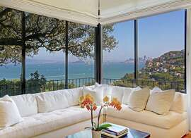 54 Lower Crescent Ave. in Sausalito features walls of glass that frame views of downtown San Francisco.