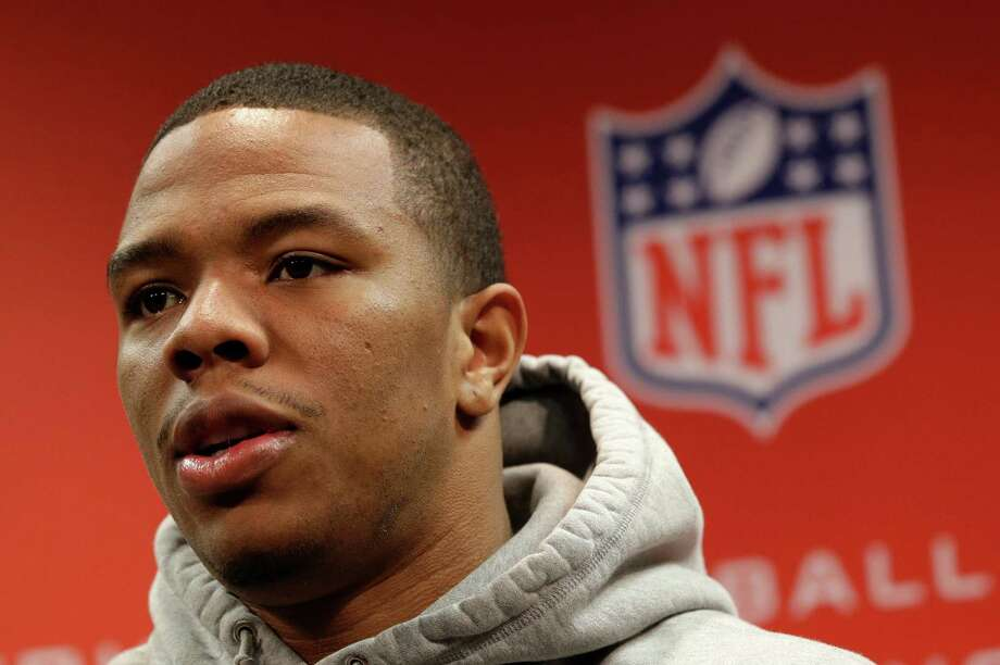FILE - In this Jan. 16, 2013, file photo, Baltimore Ravens running back Ray Rice speaks during a news conference at the team's practice facility in Owings Mills, Md. At least four television networks say they plan to stop or minimize airings of video showing football player Rice striking his fiancee, footage that has called into question how the NFL disciplines players involved in domestic violence. The video from a casino elevator showing Janay Palmer crumbling to the floor after a punch has already been seen many times on TV since TMZ released it Monday, Sept. 8, 2014. (AP Photo/Patrick Semansky, File) Photo: Patrick Semansky, STF / AP