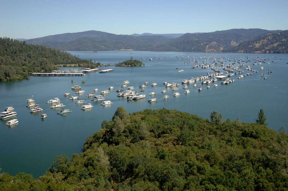 In these before-and-after images, the Bidwell Marina at Lake Oroville in Oroville, Calif., is seen. Here, the reservoir is near full on July 20, 2011. (Photo by Paul Hames/California Department of Water Resources via Getty Images.)