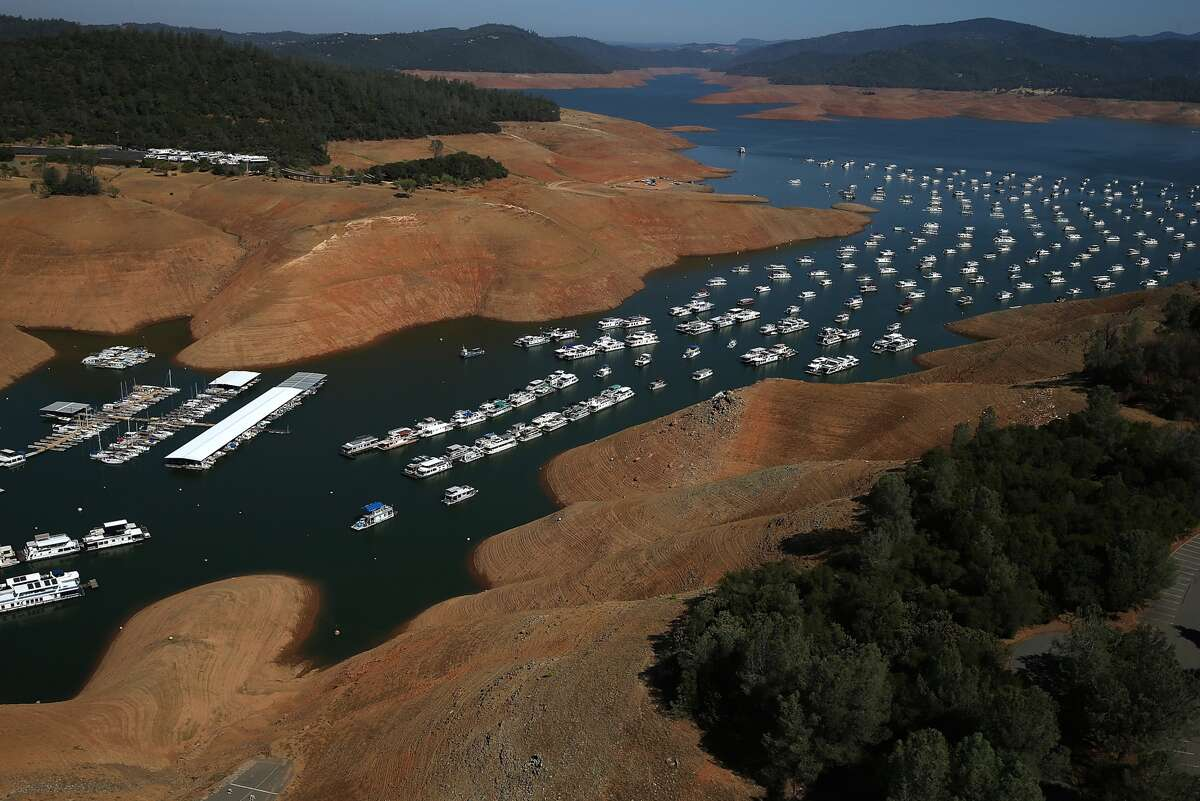 Here, Lake Oroville is nearly dry on Aug. 19, 2014. As the severe drought in California continues for a third straight year, water levels in the state's lakes and reservoirs are reaching historic lows. Lake Oroville was at 32 percent of its total 3,537,577 acre feet in August. (Photo by Justin Sullivan/Getty Images.)