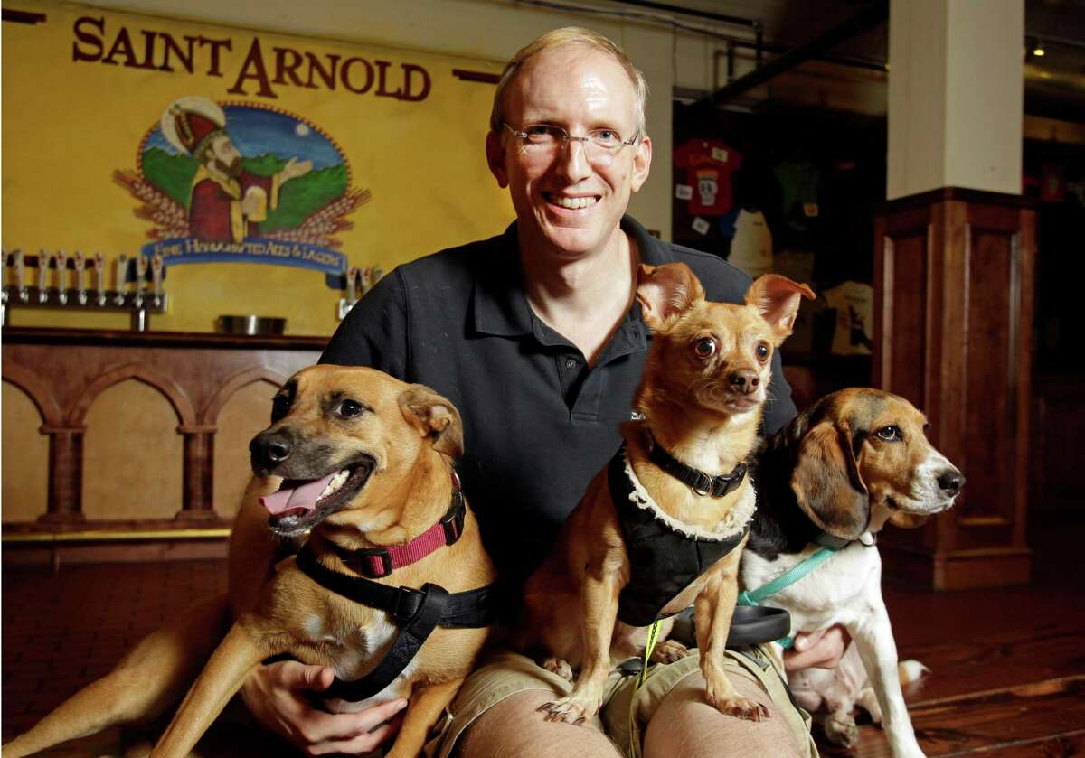 Brock Wagner, owner of Saint Arnold Brewing Co., has three rescue dogs, from left, Frida, Bucky and Jackson. His company will help the BARC animal shelter, a city-run organization that promotes efforts to spay, neuter and adopt pets.