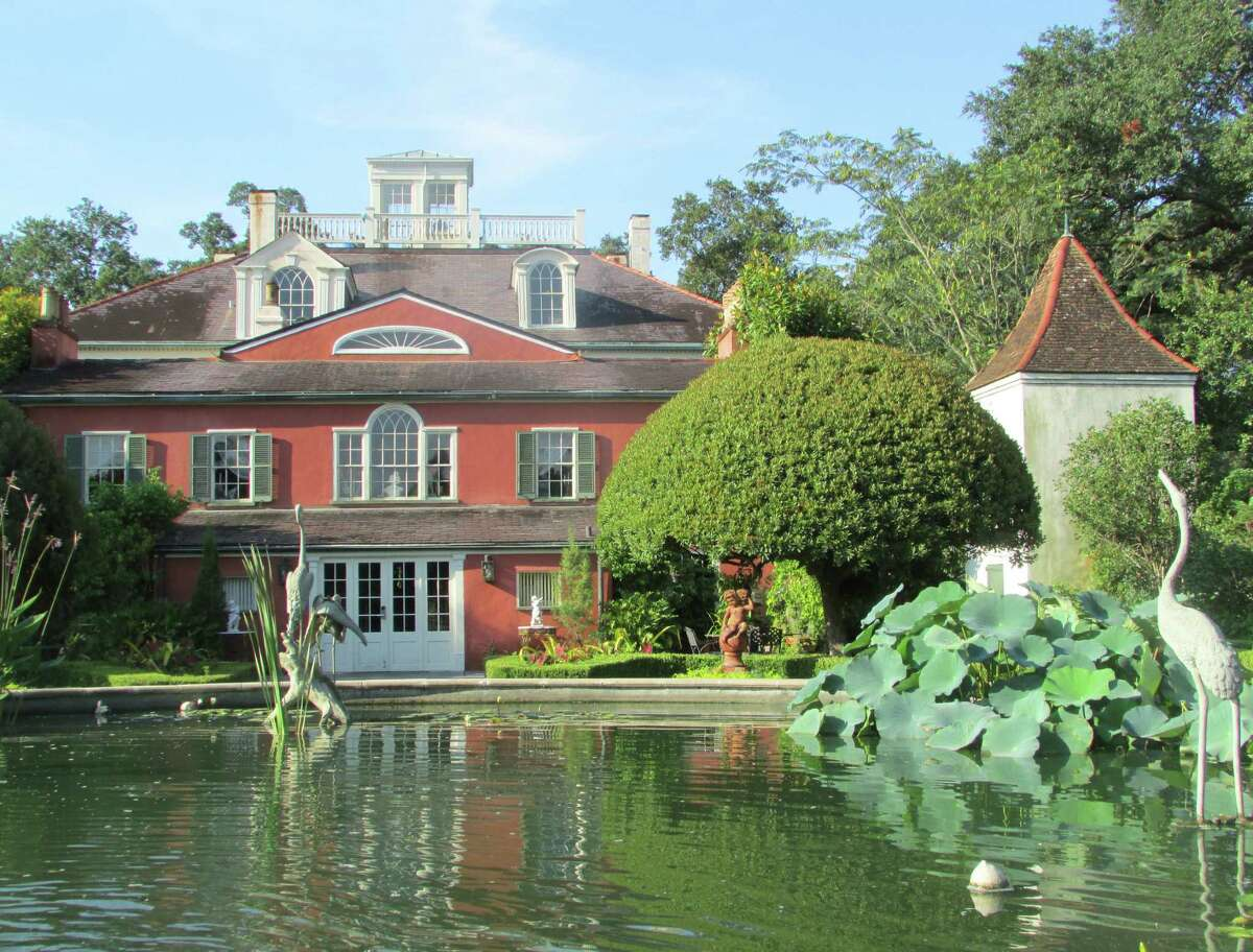 Manicured gardens and a pond frame the stately Houmas House.