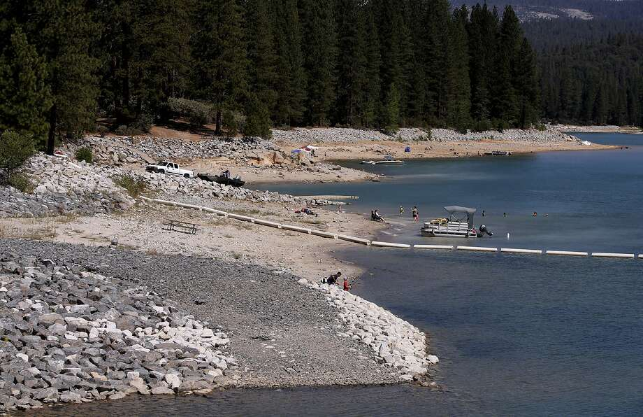Visitors adapt to the lower water levels at the lake which is at at sixty percent of capacity at Bass Lake on Friday July 18, 2014, near Oakhurst, Calif. Photo: Michael Macor, The Chronicle
