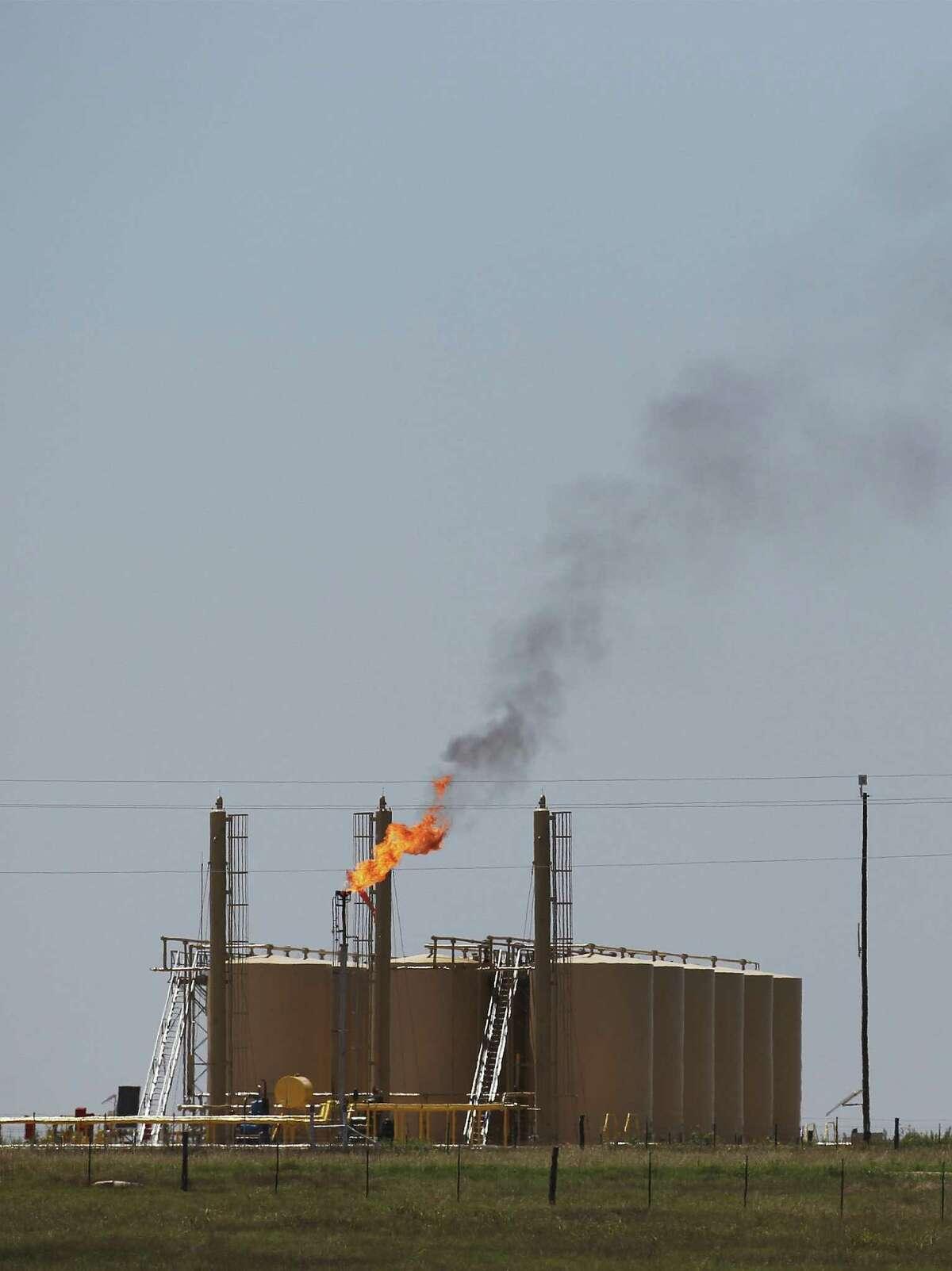 A flare burns on FM 81 near Karnes City, Texas on Thursday, May 15, 2014.