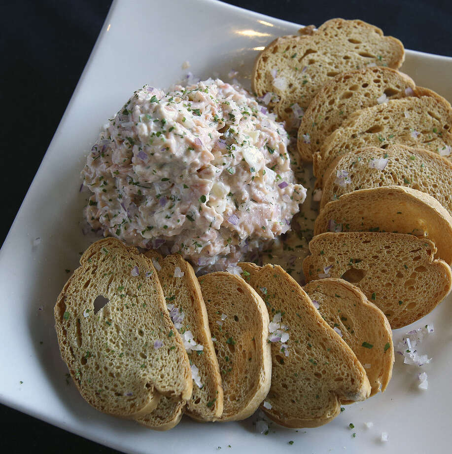 J. Alexander's at the Quarry utilizes a special smoker box to preserve the flavor of the fish in its Smoked Salmon Dip. Photo: TOM REEL