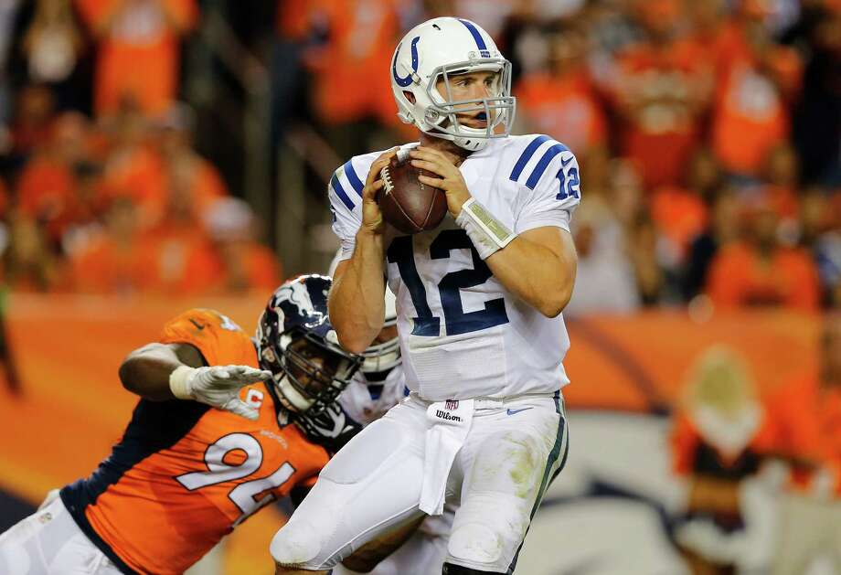 Indianapolis Colts quarterback Andrew Luck (12) throws under pressure from Denver Broncos defensive end DeMarcus Ware (94) during the second half of an NFL football game, Sunday, Sept. 7, 2014, in Denver. (AP Photo/Jack Dempsey) Photo: Jack Dempsey, Associated Press / FR42408 AP
