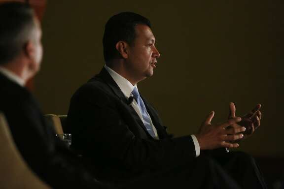 "Alex Padilla (right) answers a question during ""A Conversation with California's Secretary of State Candidates"" presented by the Public Policy Institute of California as Pete Peterson(left), executive director Davenport Institute, Pepperdine University looks on at the Sheraton Grand Hotel on Thursday, September 11,  2014 in Sacramento, Calif."