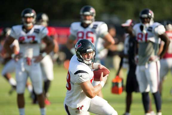Houston Texans tight end Garrett Graham (88) runs with the football after making a catch during Texans training camp at the Methodist Training Center Wednesday, Aug. 13, 2014, in Houston.  ( Brett Coomer / Houston Chronicle )