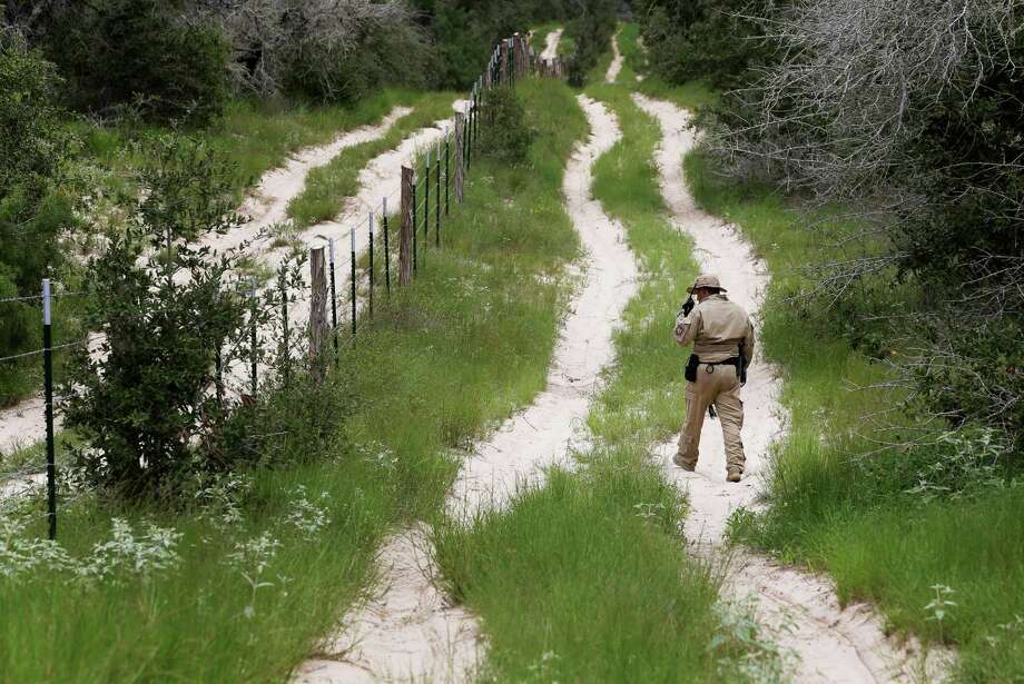FILE - In this Sept. 5, 2014 file photo, a U.S. Customs and Border Protection Air and Marine agent looks for signs along trail while on patrol near the Texas-Mexico border near McAllen, Texas. Photo: Eric Gay, STF / AP