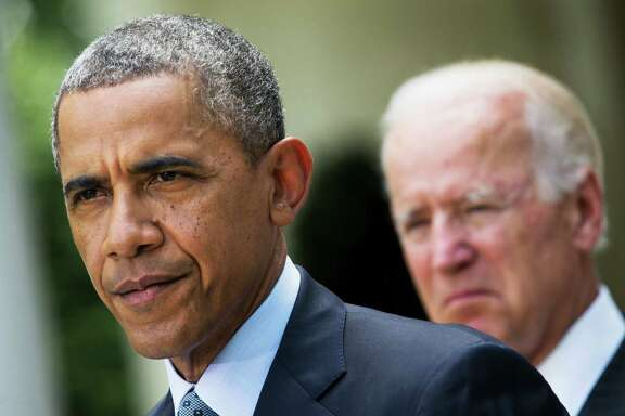 FILE - In this June 30, 2014 file photo, President Barack Obama, accompanied by Vice President Joe Biden, pauses while making a statement about immigration reform, in the Rose Garden of the White House in Washington. President Barack Obama, who has postponed until after Election Day his plan for executive actions that could shield millions of immigrants from deportation, is already on pace this year to deport the fewest number of immigrants since at least 2007, according to a new analysis of Homeland Security Department figures by The Associated Press.  (AP Photo/Jacquelyn Martin, File)