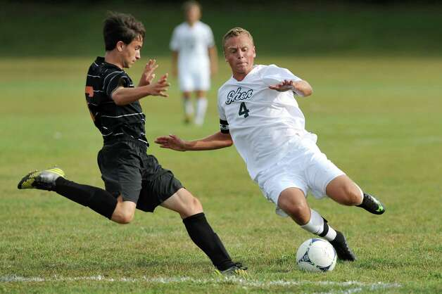 Bethlehem's Noah Weinstock, left, and Shen's Marvin Tucker both attack the ball during their soccer game on Thursday, Sept. 11, 2014, at Shenendehowa High in Clifton Park N.Y. (Cindy Schultz / Times Union) Photo: Cindy Schultz / 00028558A