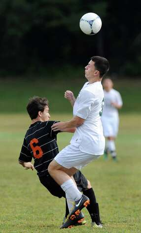 Shen's Dante Cilento, right, gets the header as Bethlehem's Noah Weinstock defends during their soccer game on Thursday, Sept. 11, 2014, at Shenendehowa High in Clifton Park N.Y. (Cindy Schultz / Times Union) Photo: Cindy Schultz / 00028558A