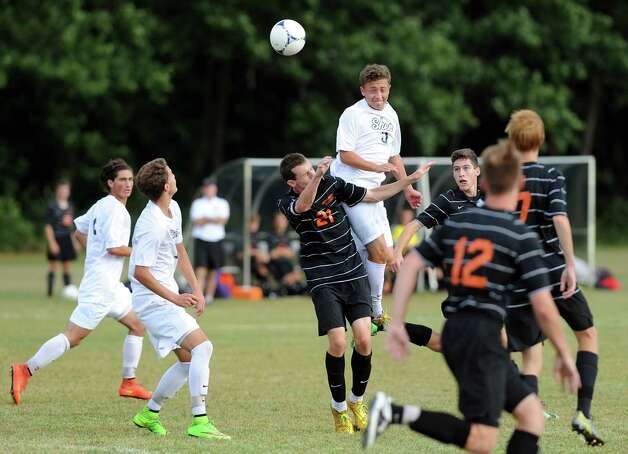 Shen's Michael Miner, center, gets the header as Bethlehem's Nick Redmond defends during their soccer game on Thursday, Sept. 11, 2014, at Shenendehowa High in Clifton Park N.Y. (Cindy Schultz / Times Union) Photo: Cindy Schultz / 00028558A