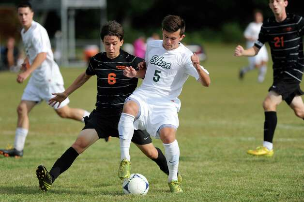 Bethlehem's Noah Weinstock, left, and Shen's Miles Burbank battle for control during their soccer game on Thursday, Sept. 11, 2014, at Shenendehowa High in Clifton Park N.Y. (Cindy Schultz / Times Union) Photo: Cindy Schultz / 00028558A