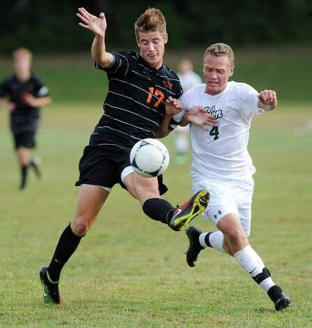 Bethlehem's Ben Licht, left, connects with the ball as Shen's Marvin Tucker defends during their soccer game on Thursday, Sept. 11, 2014, at Shenendehowa High in Clifton Park N.Y. (Cindy Schultz / Times Union) Photo: Cindy Schultz / 00028558A